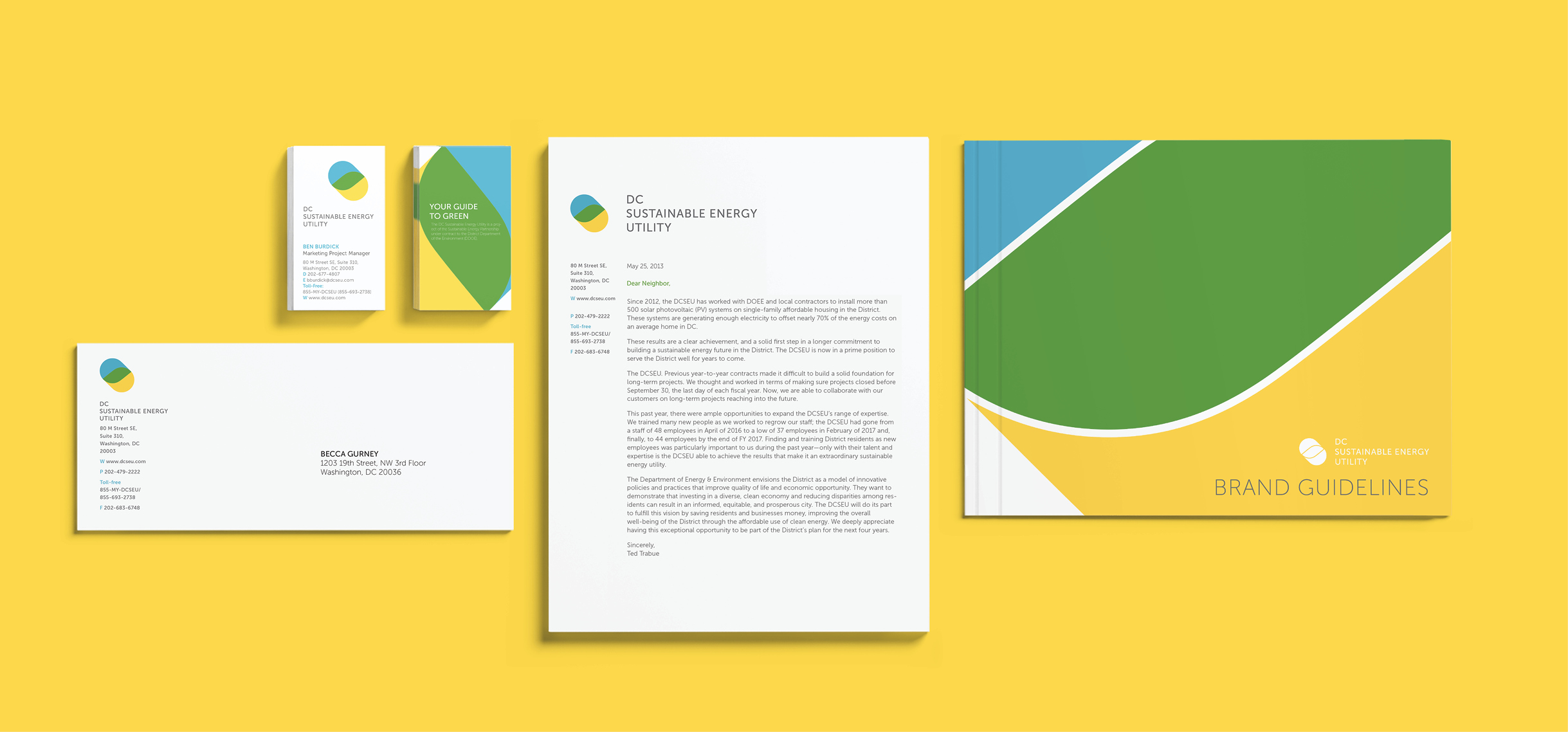 The stationary set including letterhead, business card, envelope and the Brand Guide book. All items are neatly arranged and aligned on a yellow background.