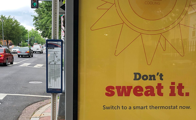 Design Chocie are marketing campaign art directors and designers: Closeup of bushelter ad with the tagline Don't Sweat It, Switch to a Smartthermostat now. The ad is yellow with a red type and a red line illustaration of a sun/thermostat