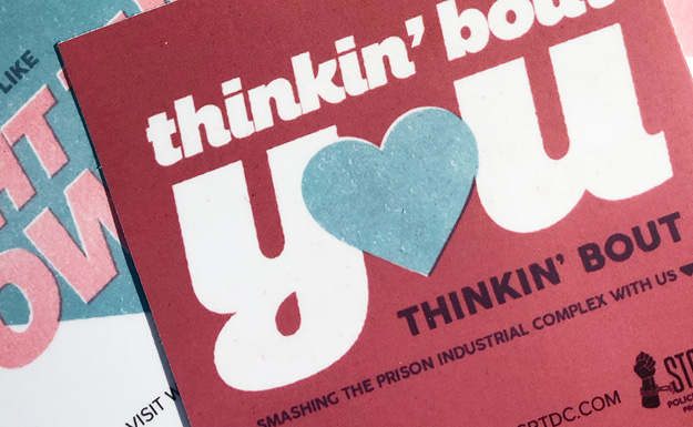 Design Choice are marketing design specialists: Close up of a valentine reading Thinking 'bout you thinking 'bout smashing the prison industrial complex with us